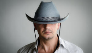 Man with cowboy hat can't use iPhone face id